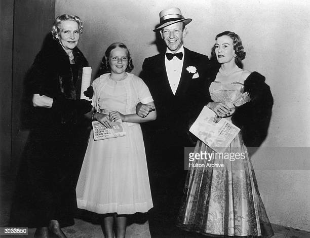 American dancer singer actor Fred Astaire poses with his mother Ann his daughter Ava and his first wife Phyllis at the premiere of the film 'The Band...