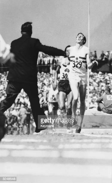 English athlete Roger Bannister winning the mile race at the Empire Games in Vancouver