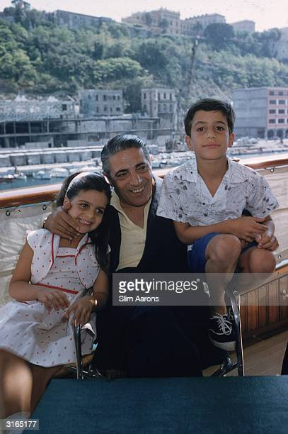 Greek shipping magnate Aristotle Onassis with his children Christina and Alexander on board his luxury yacht 'Christina' in Monte Carlo harbour