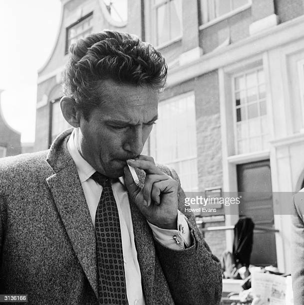 British actor Peter Finch at Pinewood Studios for the filming of the Michael McCarthy picture 'Operation Amsterdam'