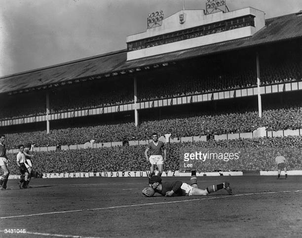 Harry Gregg the Manchester United goalkeeper making a save during a game