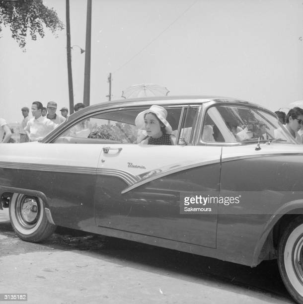 Japanese film actress Ayako Wakao owns a 1957 Ford car She is driven by her sister