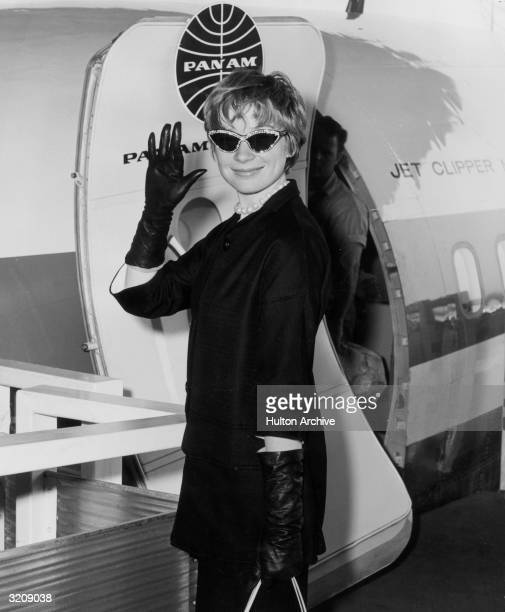 American actor Shirley MacLaine waves as she boards an airplane bound for Italy to attend the Venice Film Festival, where director Billy Wilder's...