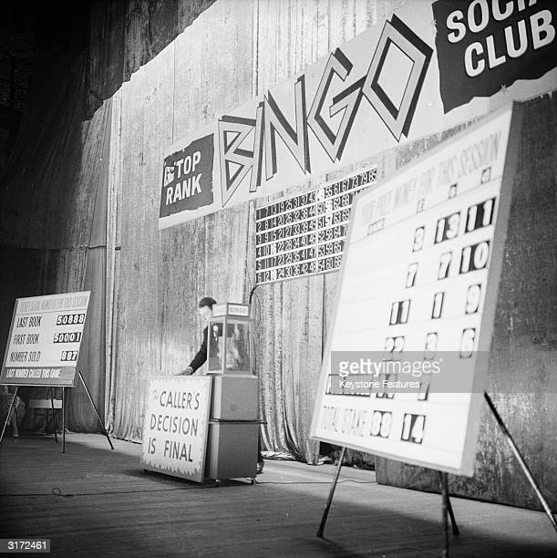 A bingo caller calls out numbers for a game of bingo in the Trocadero Cinema at the Elephant and Castle London
