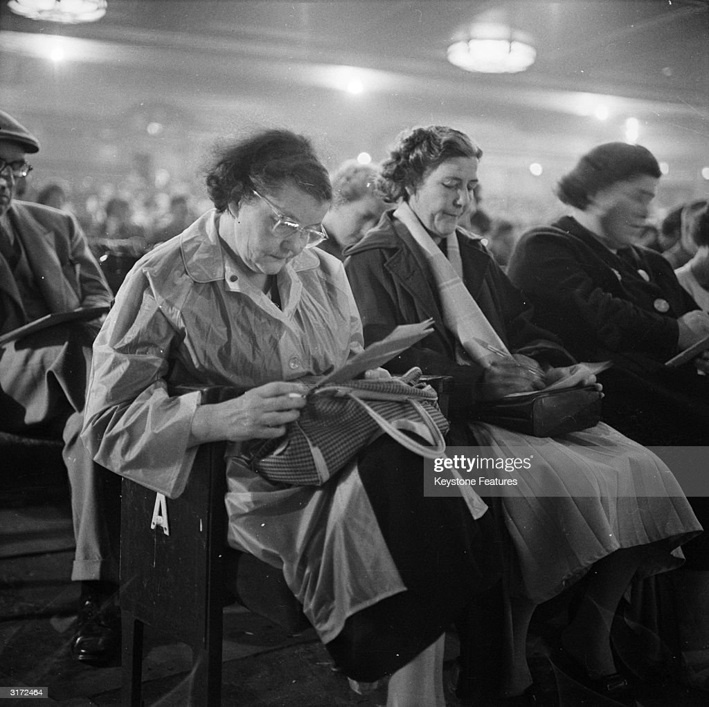 A group of women listen out for their numbers at a game of bingo in the Trocadero Cinema at the Elephant and Castle, London.