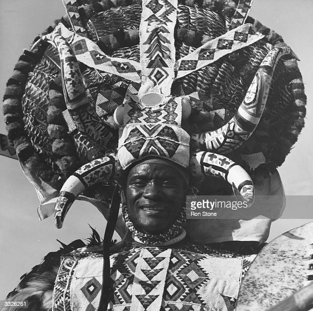 A man of the Zulu people wearing an elaborate headdress in South Africa