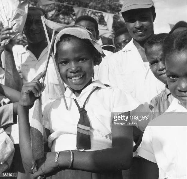 A Jamaican schoolgirl in Kingston with the countries new flag during Jamaica's independence celebrations