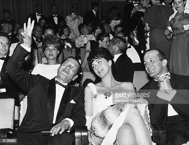 Russian ballet dancer Serge Lifar with the American opera singer Anna Moffo and the actor and director Mario Lanfranchi at the Venice film festival