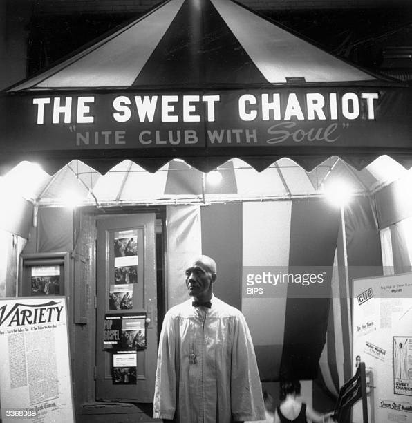 Doorman Buxie Keels stands at the entrance of The Sweet Chariot a gospel music nightclub near Broadway New York billed as 'the nightclub with a soul'