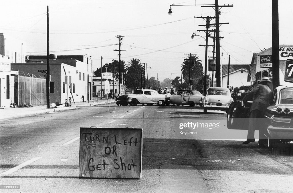 A makeshift sign urging drivers to 'Turn Left Or Get Shot' during the race riots in the Watts area of Los Angeles.