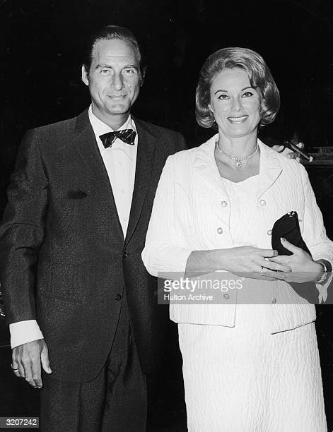 American comedian Sid Caesar and his wife Florence Levy smile as they attend the premiere of director Basil Dearden's film 'Khartoum' New York City