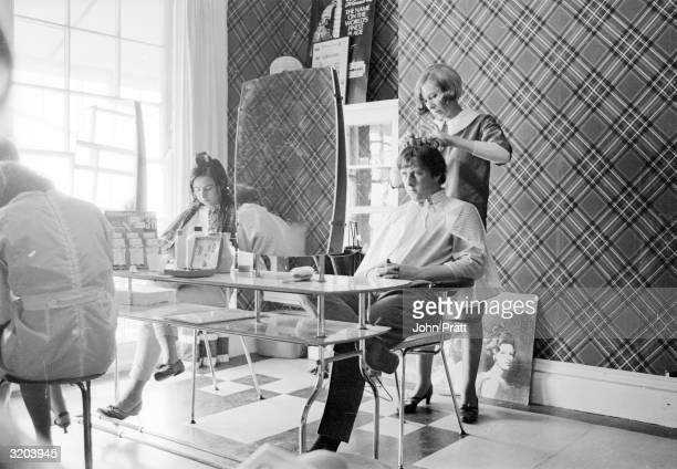 Residents in the beauty parlour of the 'Caribbean Hotel' which caters especially for teenagers on holiday in Bognor Regis Sussex