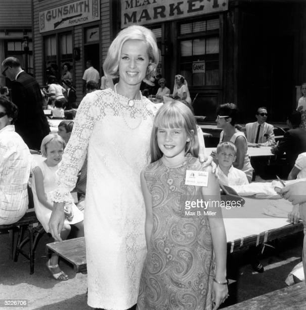 American actor Tippi Hedren and her daughter Melanie Griffith at a children's party a 'Batman' luncheon for an orphanage in California