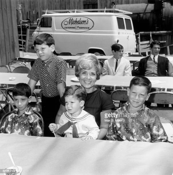 Patti Palmer wife of comedian Jerry Lewis with their children Anthony Chris Joseph and Scotty at a children's party a 'Batman' luncheon for an...