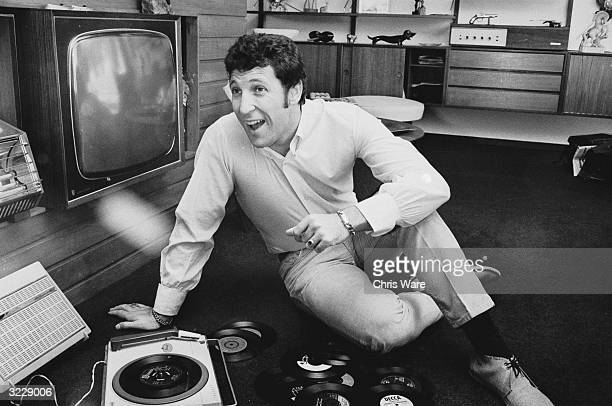 Welsh singer Tom Jones listening to his favourite records at home