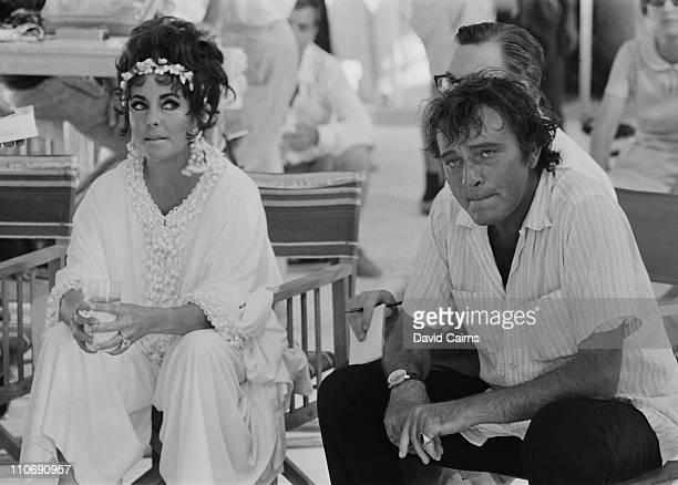 Actor Richard Burton with his wife, actress Elizabeth Taylor in Sardinia, on the set of the film 'Goforth', later titled 'Boom'.