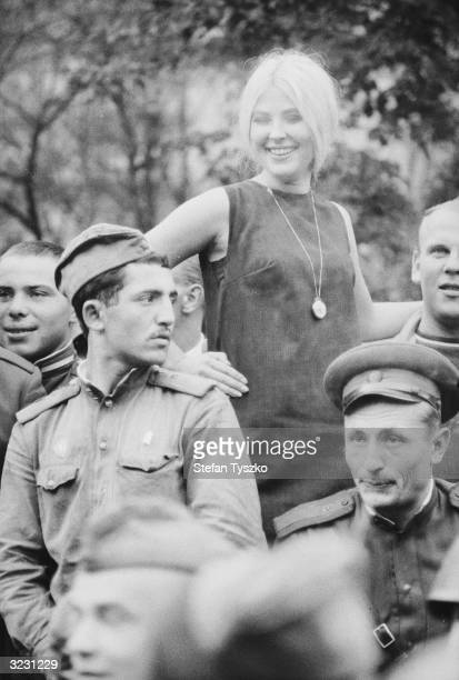A Czech prostitute seen with Soviet soldiers at their encampment in a Prague park during their country's invasion of Czechoslovakia