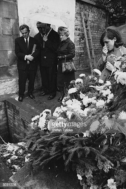 A family mourns at the graveside of their son killed during the Soviet occupation of Prague