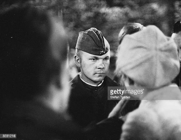 A Soviet soldier remains impassive in the face of Czech questioning during the Soviets' occupation of Prague