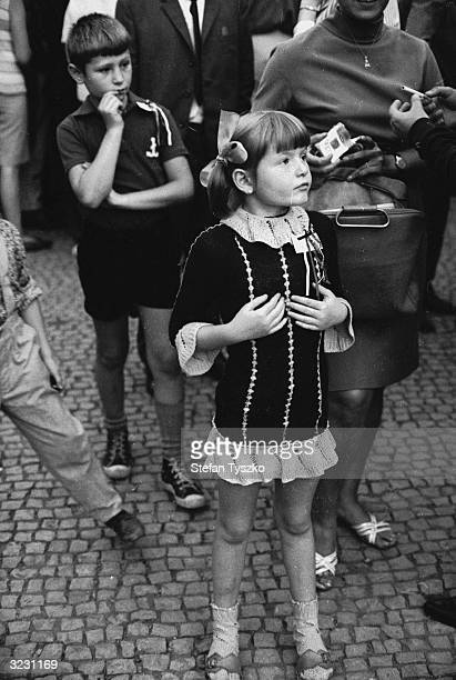 A young Czechoslovakian girl watches events unfold in St Wenceslas Square Prague during the Soviet invasion