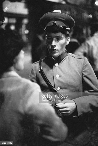 A young Soviet soldier listens to the concerns of a Prague resident during his country's invasion of Czechoslovakia