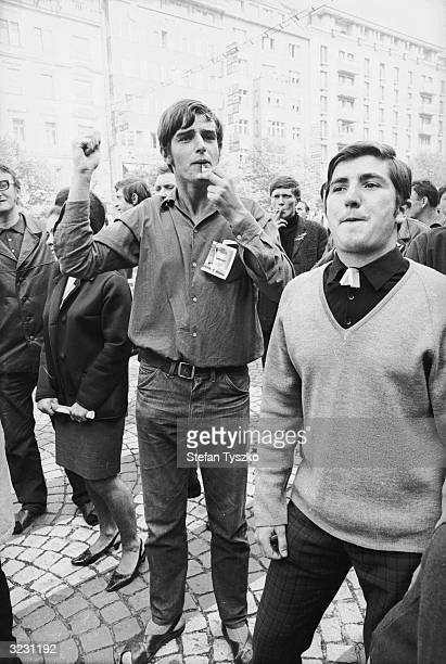 Prague residents take to the streets to whistle and jeer soldiers during the Soviet invasion of their country