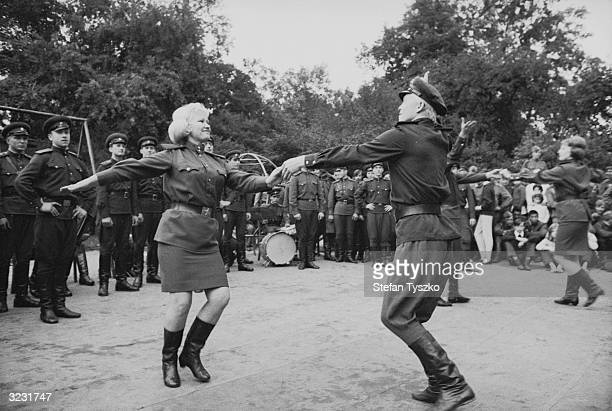 The Red Army Ensemble dancing to entertain Soviet troops at their encampment in a Prague park during their country's invasion of Czechoslovakia