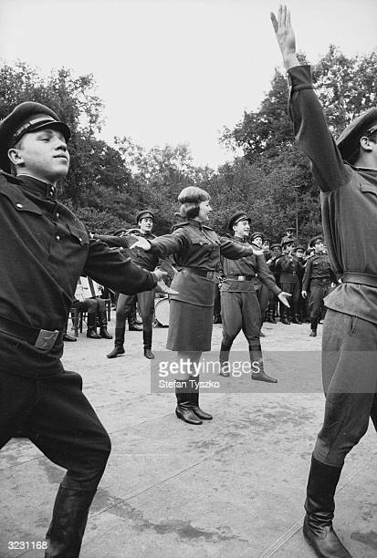 The Red Army Ensemble entertain Soviet troops in their encampment in a Prague park during their country's invasion of Czechoslovakia