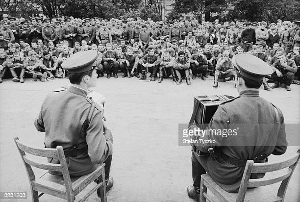 The Red Army Ensemble entertaining Soviet troops at their encampment in a Prague park during their country's invasion of Czechoslovakia
