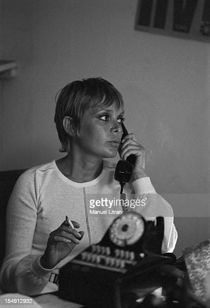 August 1969 Annie FARGUE producer of the musical 'Hair' in his office in Paris on the phone with a cigarette