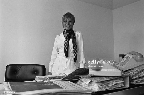 August 1969 Annie FARGUE producer of the musical 'Hair' in his office in Paris wearing a scarf around his neck