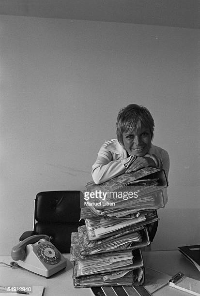 August 1969 Annie FARGUE producer of the musical 'Hair' in his office in Paris the chin rest on a pile of files