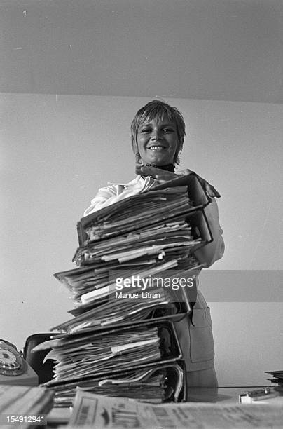 August 1969 Annie FARGUE producer of the musical 'Hair' in his office in Paris behind a stack of files