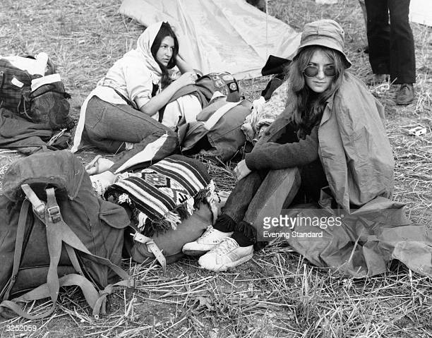 Two pop fans with their luggage camping at Freshwater, Isle of Wight, waiting for the pop festival due to start a week hence.