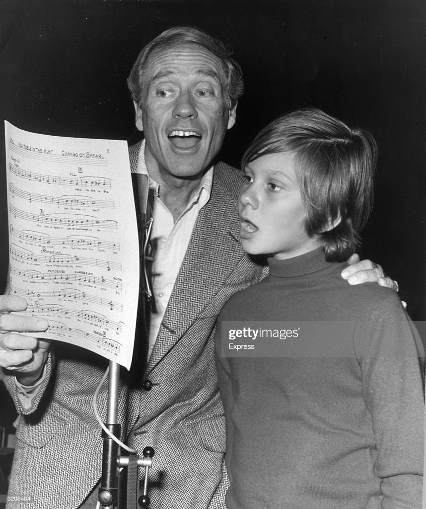 American actor Mel Ferrer (L) and his son with Audrey Hepburn, Sean, sing while reading sheet music in a recording studio, London, England. They recorded an album, 'Chango On Safari,' based on Ferrer's original story.