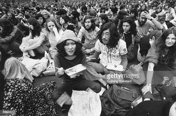 Japanese hippies amongst the large crowd at the Rock 'n' Roll Festival at Wembley Stadium London Among them is Mei Wei