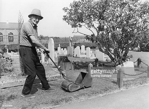 The gardener Colonel Bowers mowing grass in a graveyard