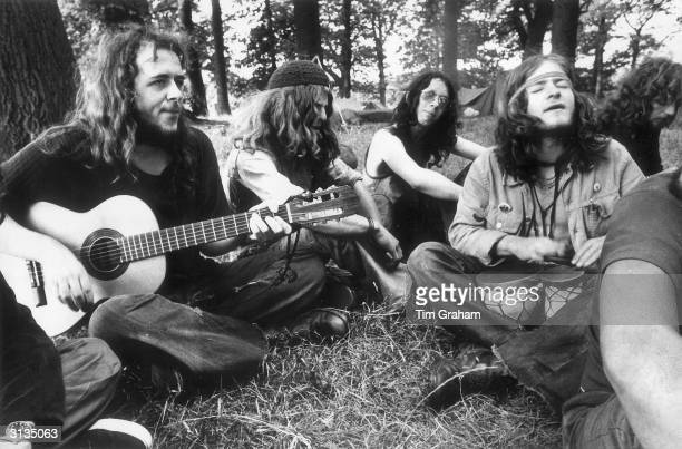 Hippies enjoying an impromptu jam session before the Festival of the People in Windsor Great Park