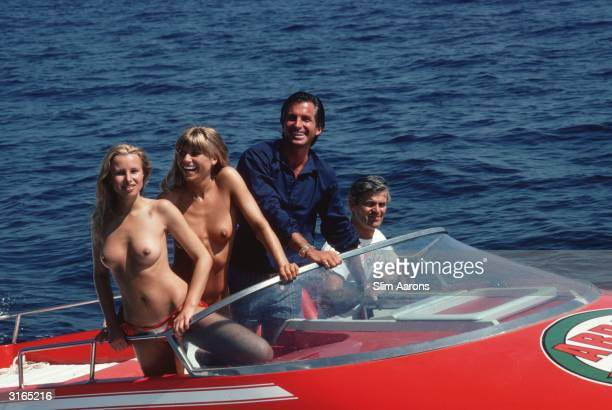 Actor George Hamilton takes off in a speedboat with friends Ruth Luthi and Mike Belami during a stay in St Tropez