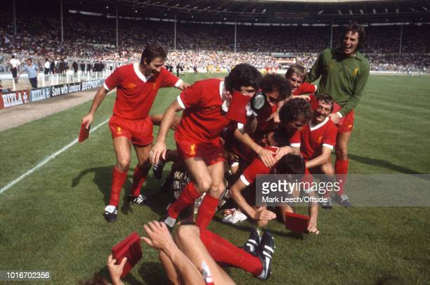 11 August 1979 Wembley Football Association Charity Shield Arsenal v Liverpool Kenny Dalglish pushes his teammates over as they pose with the trophy...