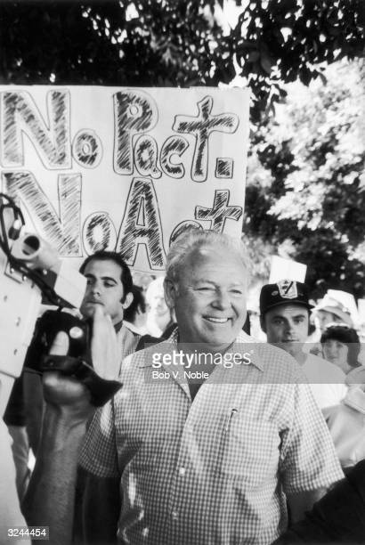 American actor Carroll O'Connor smiles as he joins the picket line in front of the 20th Century Fox Studios during the Screen Actors Guild/American...