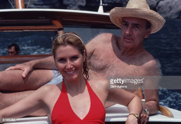 Prince Sforza Ruspoli and Princess Pia Ruspoli sunbathing on the deck of a motor boat at Capri Italy