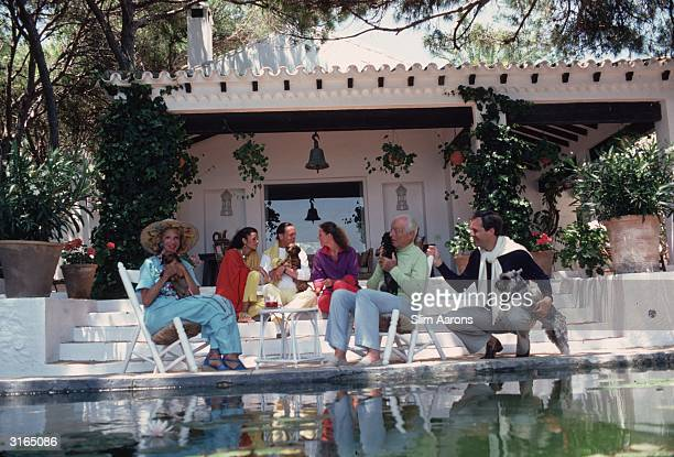 The Rothschild family round the pool at their home the villa Santa Margarita reputed to be the most beautiful house in Marbella From l to r...