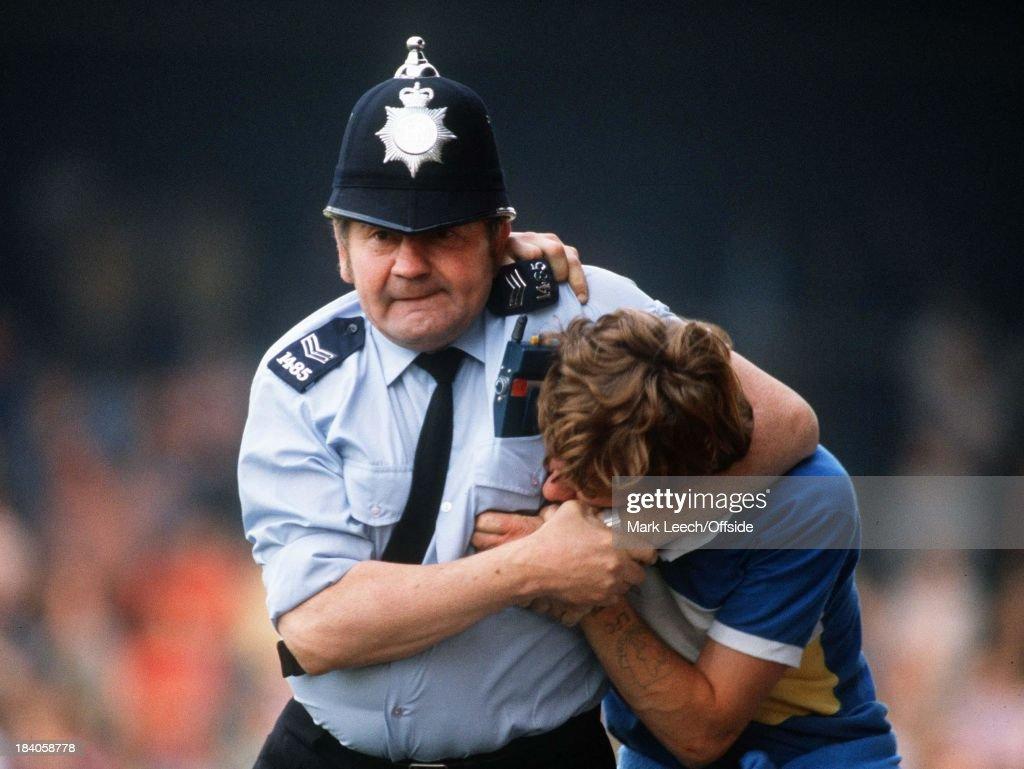 Football Fan In Police Headlock : News Photo