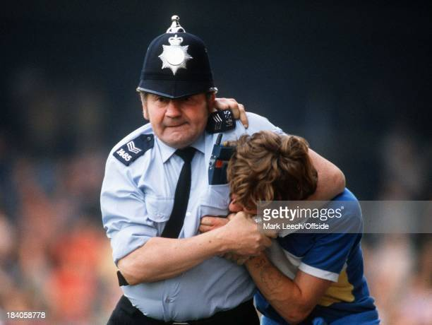 04 August 1981 Friendly football match Scunthorpe United v Liverpool A Liverpool fan is put in a headlock by an enthusiastic policeman