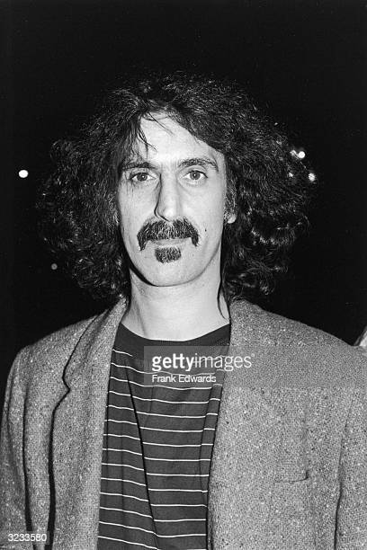 Headshot of hard rock musician and composer Frank Zappa wearing a striped Tshirt under a tweed jacket attending the opening night of Chaplin Los...
