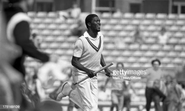 August 1984 The Oval - Cricket - 5th Test England v West Indies - Joel Garner runs off the pitch with a stump in each hand, as the spectators invade...