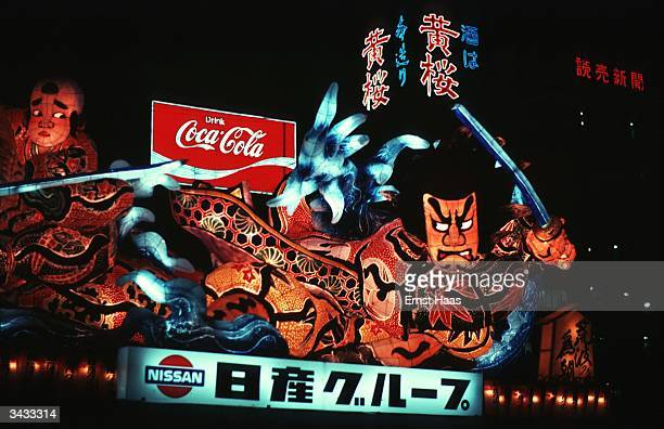An illuminated papiermache float in the Nebuta Festival held in Aomori city at the beginning of August showing stylised faces The Nebuta festival...