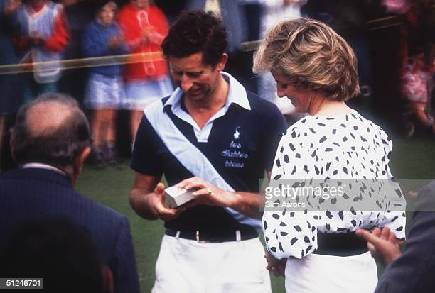 August 1985, Charles, Prince of Wales, after playing polo for the Diables Blues at Cowdray Park in Sussex, with Diana, Princess of Wales .