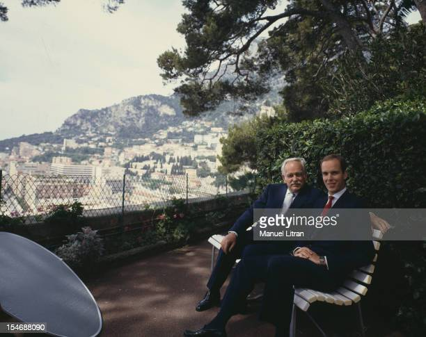 August 1986 Prince Rainier and Prince Albert of Monaco on a bench in the garden of their palace